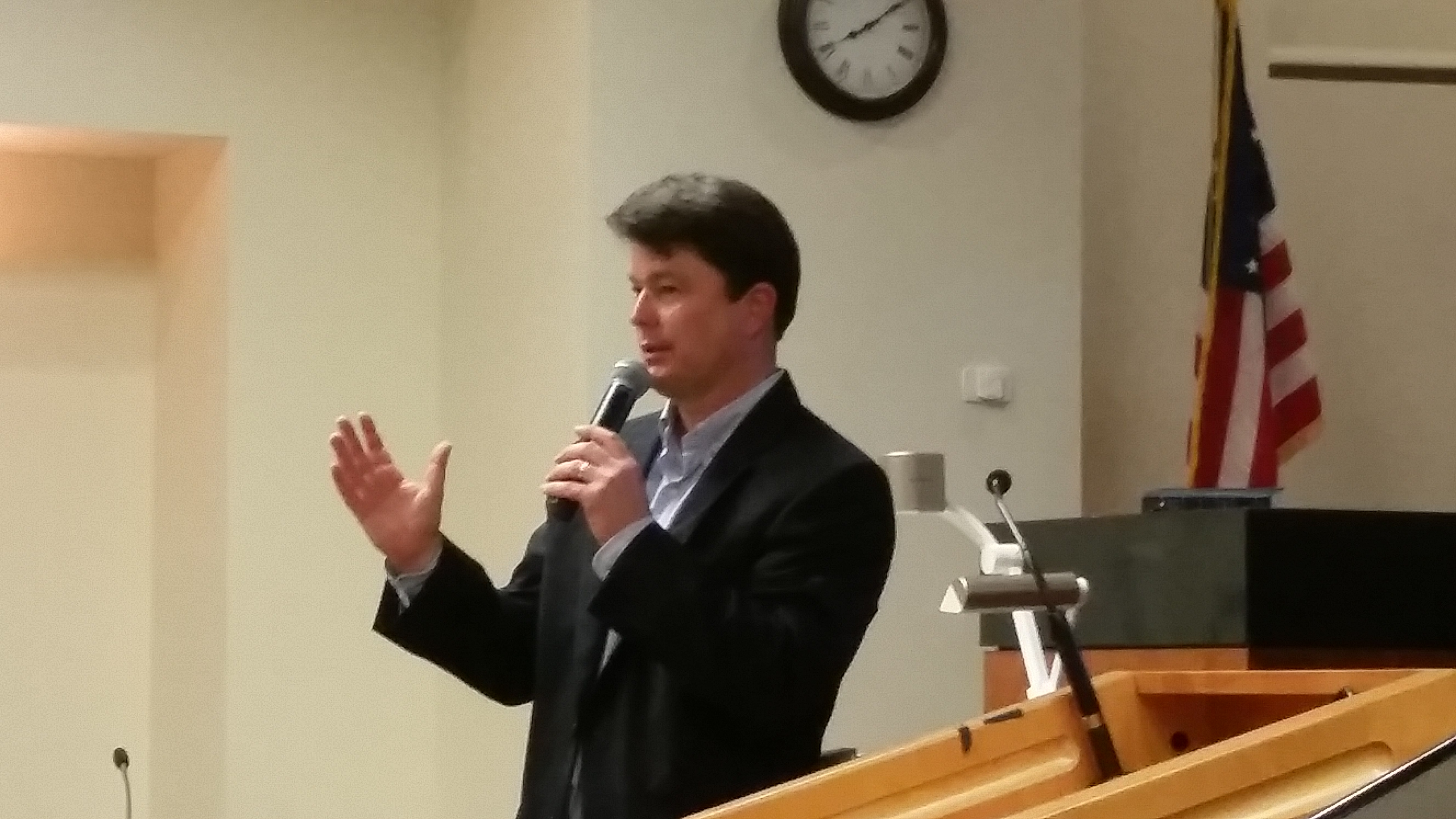 Photo: Kurt Naas explains Cintra finances to a crowd of 150 at Cornelius Town Hall