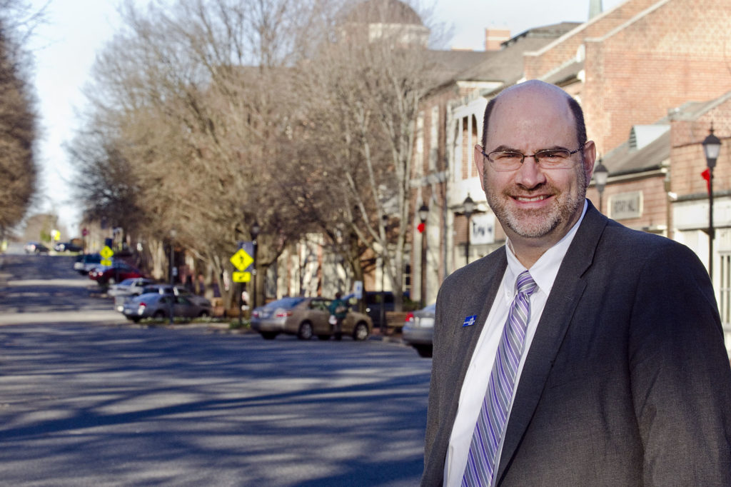 Kannapolis City Manager Mike Legg poses for a portrait on West Ave., in downtown Kannapolis, on Jan. 13.